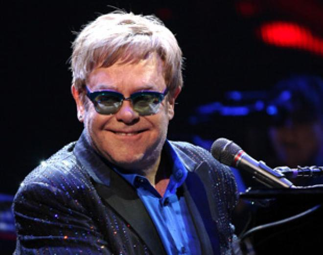 Win two premium tickets to see Elton John